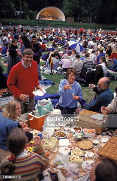 Crowds enjoy picnic spreads before an outdoor concert at Kenwood House, North London, on 18th May 1995, in London, England. Set in Hampstead Heath,...