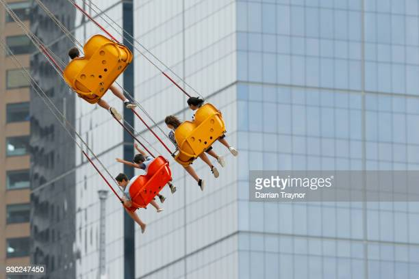 Crowds enjoy the carnival rides during Birdman Rally on March 11 2018 in Melbourne Australia The annual charity event sees entrants in home made...