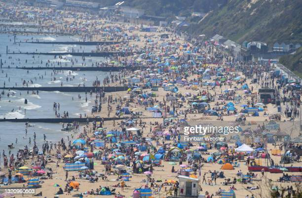 Crowds enjoy the sunshine on the beach on May 31, 2021 in Bournemouth, England.