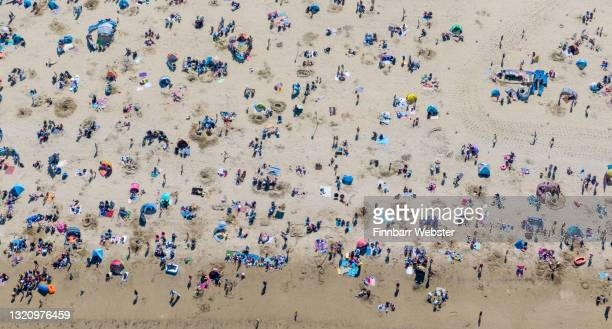 Crowds enjoy the sunshine on the beach on May 31, 2021 in Weymouth, England. Britons have flocked to the seaside and parks to enjoy the Bank Holiday...