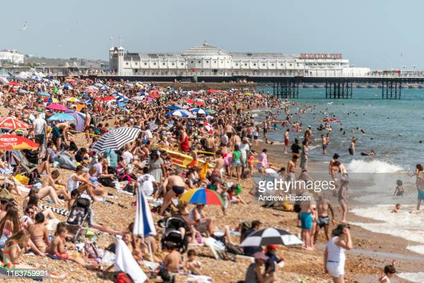 Crowds enjoying the beach on Brighton's hottest day ever on July 23 2019 in Brighton England