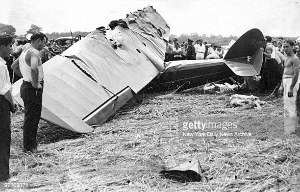 Crowds examine the wreckage of a Cessna plane that crashed and killed Islamic leader Sufi Abdul Hamid and the pilot Fred Burkhardt Kay Price Hamid's...
