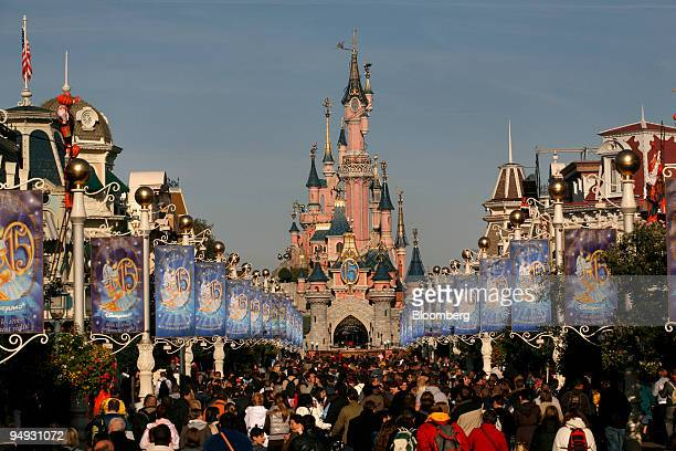 Crowds fill 'Main Street USA' at Disneyland Resort Paris the amusement park run by Eurodisney in MarnelaVallee near Paris France on Saturday Oct 18...