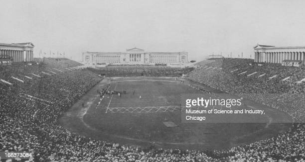 Crowds fill Soldier Field Stadium in Grant Park at the Century of Progress International Exposition in Chicago Illinois the Field Museum of Natural...