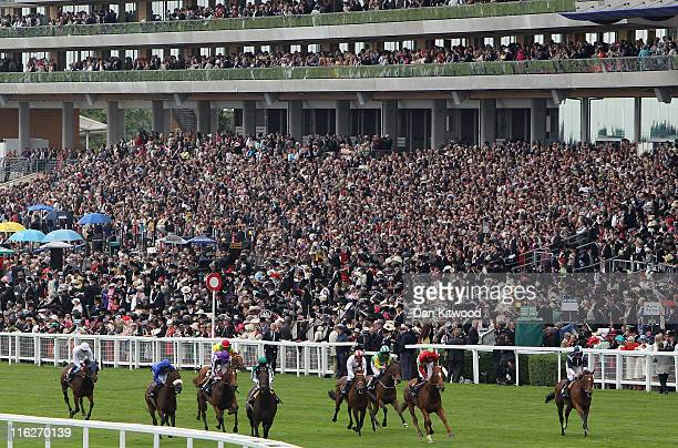 Crowds fill the grandstand as Richard Hughes riding Strong Suit win The Jersey Stakes during day two of Royal Ascot at Ascot racecourse on June 15,...