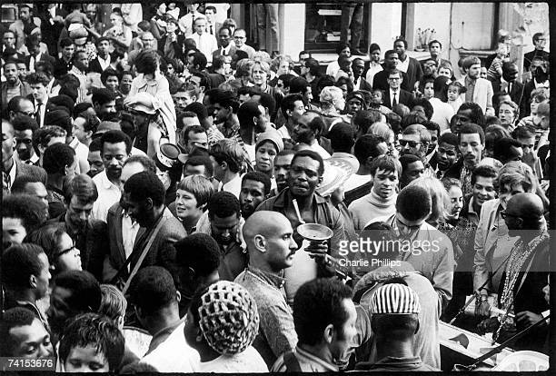 Crowds fill the street during the Notting Hill Carnival, London, August 1968.
