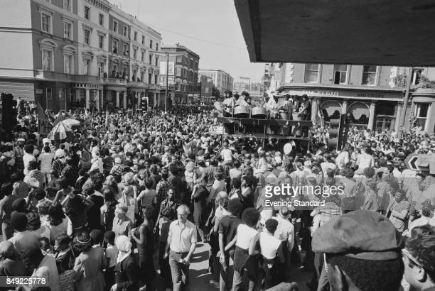 Crowds fill the street during the Notting Hill Carnival, London, UK, 31st August 1977.