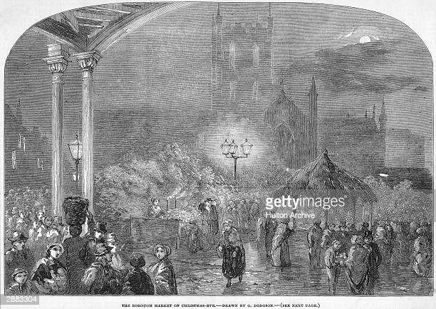 Crowds flock to London's Borough Market on Christmas Eve with Southwark Cathedral in the background circa 1850 From a drawing by G Dodgson