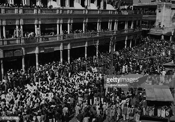 Crowds follow the funeral procession of Mahatma Gandhi