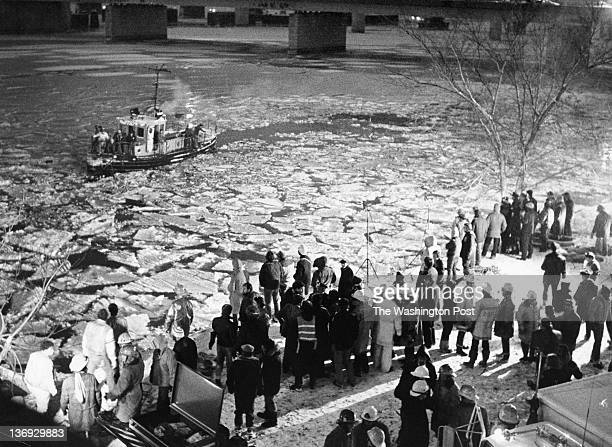 FILE Crowds gather along the frozen banks near the scene where the Air Florida Flight 90 crashed into the Potomac River on January 13 1982