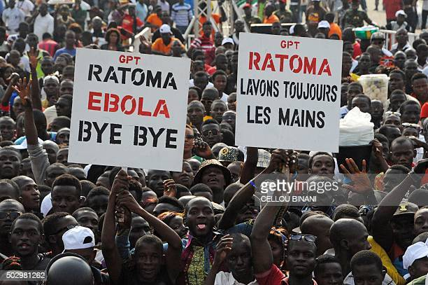 Crowds gather and cheer during the Bye bye Au revoir Ebola concert on December 30 2015 in Conakry International artists Youssou Ndour Tiken Jah...