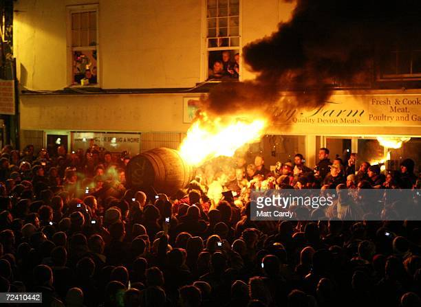 Crowds gather around a burrning barrel soaked in tar on November 4 2006 in Devon England The 400yearold event at Ottery St Mary's carnival on 4...