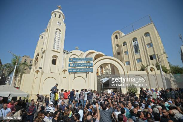 Crowds gather as Coptic Christians carry the coffins of victims killed in an attack a day earlier following a morning ceremony at the Prince Tadros...