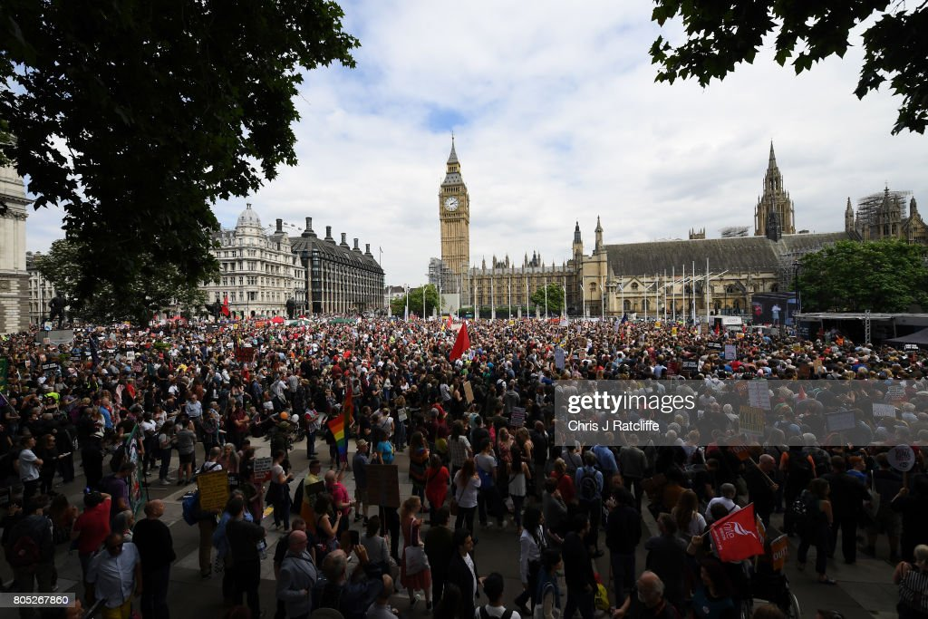 Crowds gather as they wait for Labour Party leader, Jeremy Corbyn to speak during the 'Not One Day More' march at Parliament Square on July 1, 2017 in London, England. Thousands of protesters joined the anti-Tory demonstration at BBC Broadcasting House and marched to Parliament Square. The demonstrators were calling for an end to the Conservative Government and policies of austerity.