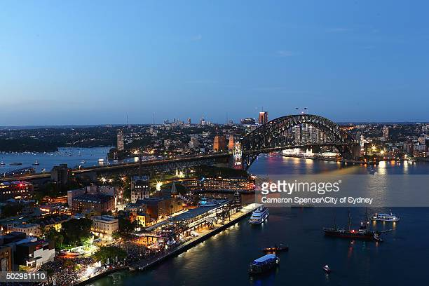 Crowds gather at dusk on New Year's Eve around Sydney Harbour on December 31 2015 in Sydney Australia