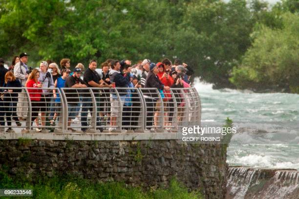 Crowds gather at Terrapin Point on Goat Island in Niagara Falls New York to watch Aerialist Erendira Wallenda hang beneath a helicopter during a...
