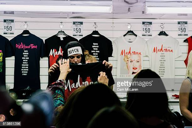 Crowds gather at the merchandise stand before Madonna's near sellout 'Rebel Heart' Tour at Vector Arena on March 5 2016 in Auckland New Zealand