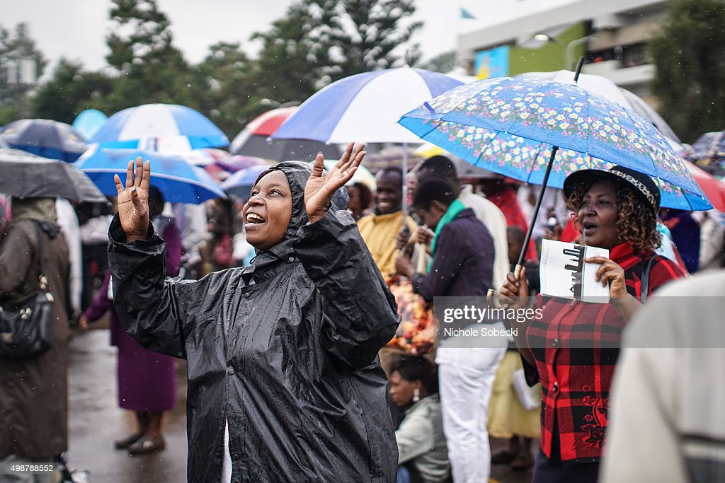 Crowds gather at the University of Nairobi grounds despite the rain on November 26, 2015, to attend a mass delivered by Pope Francis in Nairobi, Kenya. Pope Francis makes his first visit to Kenya on a five day African tour that is scheduled to include Uganda and the Central African Republic. Africa is recognised as being crucial to the future of the Catholic Church with the continent's Catholic numbers growing faster than anywhere else in the world.