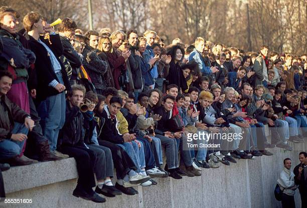 Crowds gather at the wall near the Brandenburg Gate on November 10 when East Berliners were allowed to cross into the West for the first time Hours...