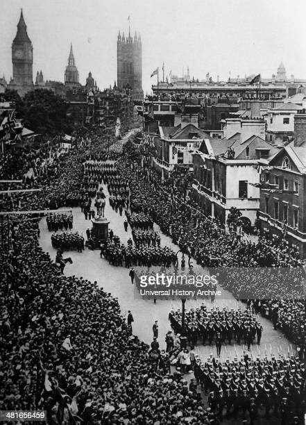 crowds gather at Westminster near Parliament in London for a victory parade 19th June 1919 to mark the peace treaty signed at Versialles after World...