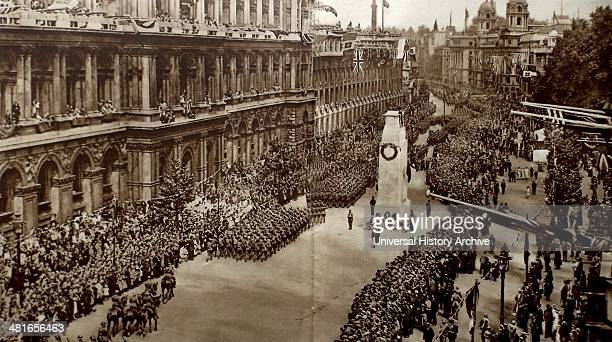 Crowds gather at Whitehall near the Cenotaph monument in London for a victory parade 19th June 1919 to mark the peace treaty signed at Versialles...