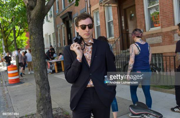 Crowds gather for an annual block party hosted by the Bushwick Collective a group of graffiti artists on Troutman Street on June 3 2017 in Brooklyn...