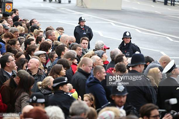 Crowds gather for the annual Remembrance Sunday Service at the Cenotaph on Whitehall on November 9 2014 in London United Kingdom People across the UK...