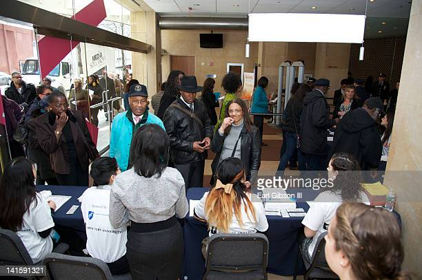Crowds gather for the 'Made Visible Women Children Poverty in America' panel discussion at the NYU Skirball Center on March 18 2012 in New York City