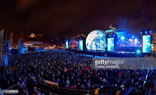Crowds gather for the public show for the 30th anniversary of the fall of the Berlin Wall, on November 9, 2019 at the Brandenburg Gate in Berlin. -...