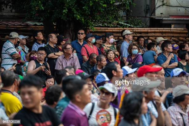Crowds gather Jenn Lann Temple as festivities begin to mark the nine day Mazu pilgrimage on April 13 2018 in Dajia near Taichung Taiwan The annual...