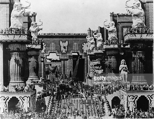Crowds gather on a huge set of an Egyptian temple in a still from the silent film 'Intolerance' directed by DW Griffith 1916