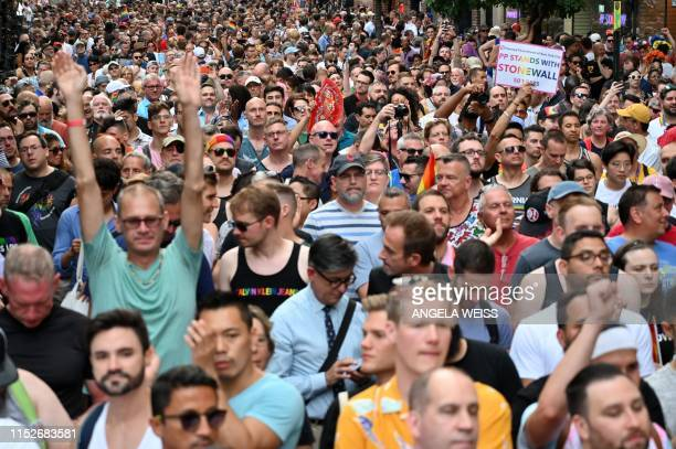 Crowds gather on Christopher Street outside the Stonewall Inn for a rally to mark the 50th anniversary of the Stonewall Riots in New York, June 28,...