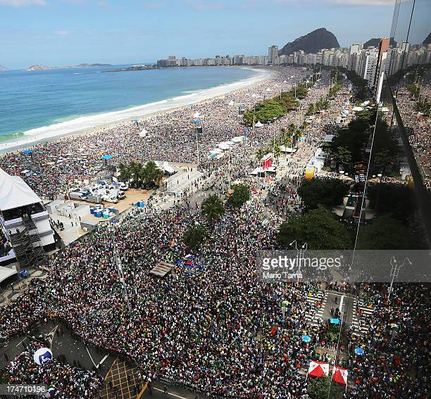 Crowds gather on Copacabana Beach during Pope Francis' final Mass on his trip to Brazil on July 28 2013 in Rio de Janeiro Brazil A reported crowd of...