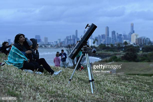 Crowds gather on Elwood beach for a chance to see the super moon on November 14 2016 in Melbourne Australia A super moon occurs when a full moon...