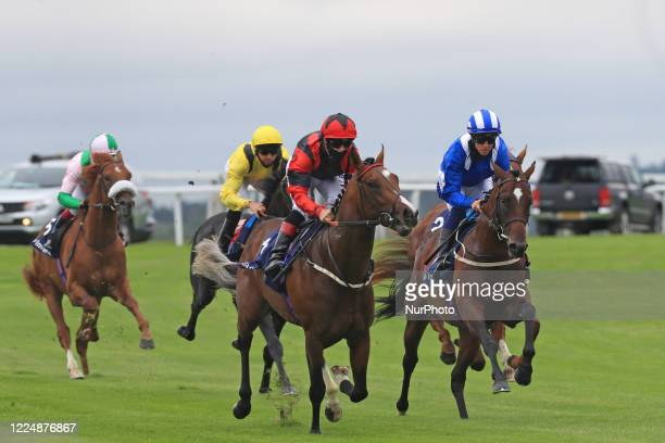 Crowds gather on Epsom Downs south of London on July 4 2020 to witness the 241st Epsom Derby which was postponed on June 6th and was contested by...
