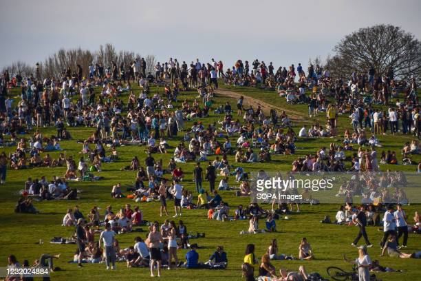 Crowds gather on Primrose Hill as a heatwave hits London. Temperatures rise in the capital, prompting large crowds to gather in the parks around the...