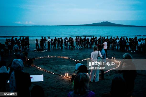 Crowds gather on Takapuna beach for a vigil in memory of the victims of the Christchurch mosque terror attacks on March 16, 2019 in Auckland, New...