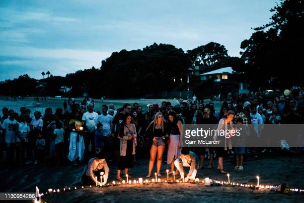 Crowds gather on Takapuna beach for a vigil in memory of the victims of the Christchurch mosque terror attacks on March 16 2019 in Auckland New...