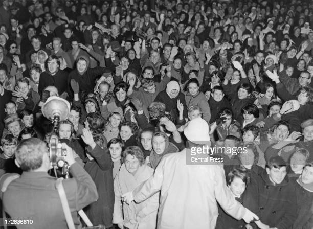 Crowds gather on the eve of the wedding of King Baudouin of Belgium and Queen Fabiola of Belgium hoping to catch a glimpse of the couple on their...