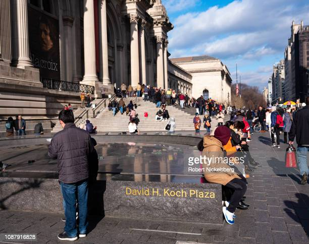 Crowds gather on the front steps of The Metropolitan Museum of Art in New York City December 26, 2018. Businessman, philanthropist and political...