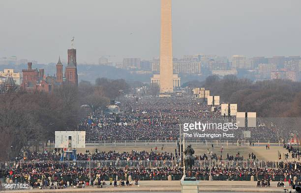 Crowds gather on the National Mall in Washington for the swearing-in ceremony of President-elect Barack Obama. The view is from behind the inaugural...