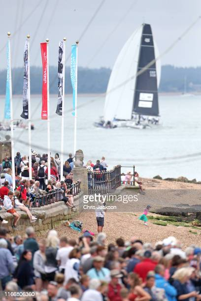 Crowds gather on the seafront to get a view of the inaugural King's Cup regatta hosted by the Duke and Duchess of Cambridge on August 08 2019 in...