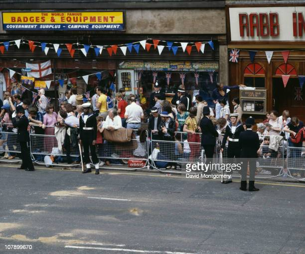 Crowds gather on The Strand to watch the wedding procession of Prince Charles and Lady Diana Spencer London 29th July 1981