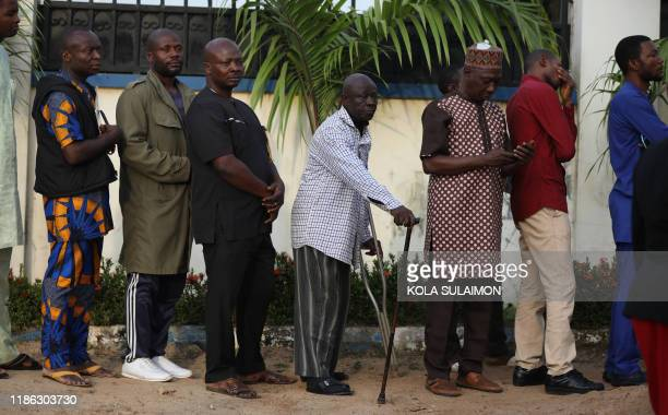 Crowds gather outside Ahmad Isah's radio studio, where he presents his Isah's Brekete Family radio show, hoping to share their problems over the...