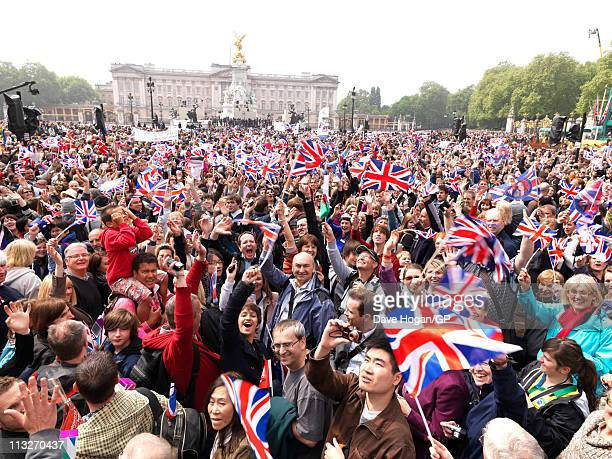 Crowds gather outside Buckingham Palace after the Royal Wedding of Prince William to Catherine Middleton on April 29, 2011 in London, England. The...