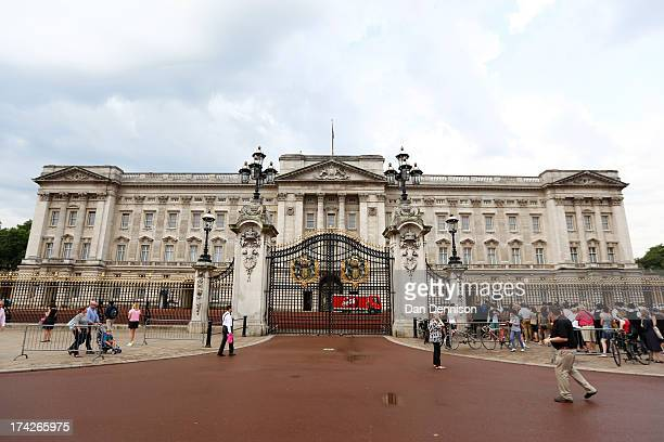 Crowds gather outside Buckingham Palace to read the easel displaying the announcement of the son of The Duke and Duchess of Cambridge on July 23 2013...