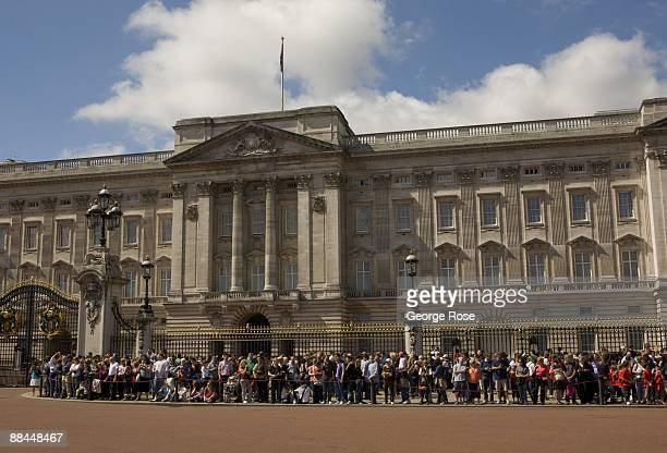 Crowds gather outside Buckingham Palace to watch the Changing of the Guard as seen in this 2009 London United Kingdom cityscape