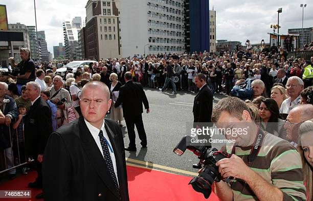 Crowds gather outside Manchester Cathedral during the wedding of footballer Gary Neville and Emma Hadfield on June 16 2007 in Manchester England