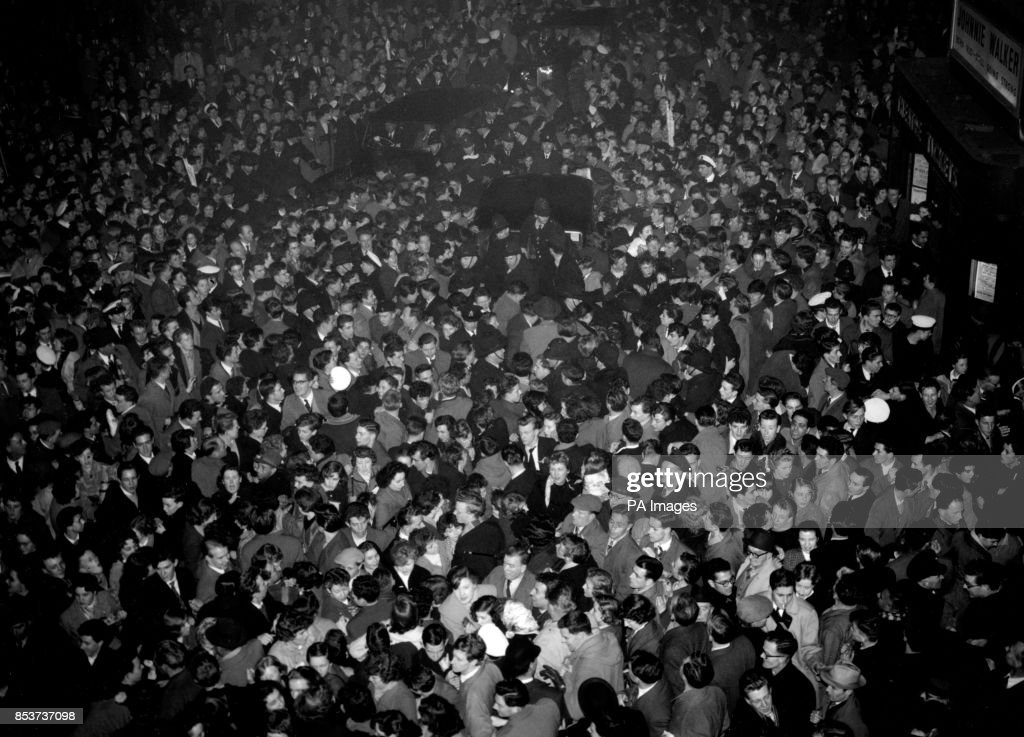 Crowds Gather Outside The Dominion Theatre In Tottenham Court Road London Where Bill Haley