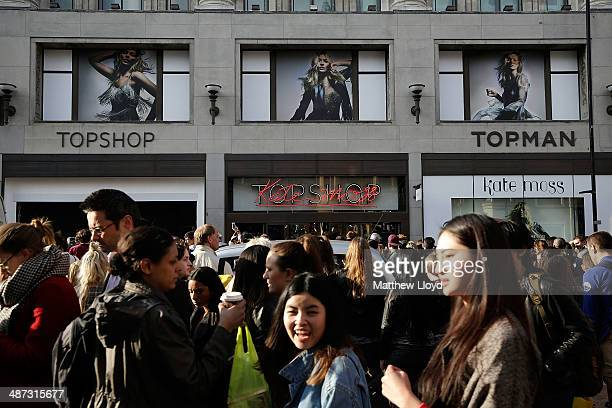 Crowds gather outside the flagship Topshop store on Oxford Circus in anticipation of the launch of Kate Moss' new clothing collection on April 29,...